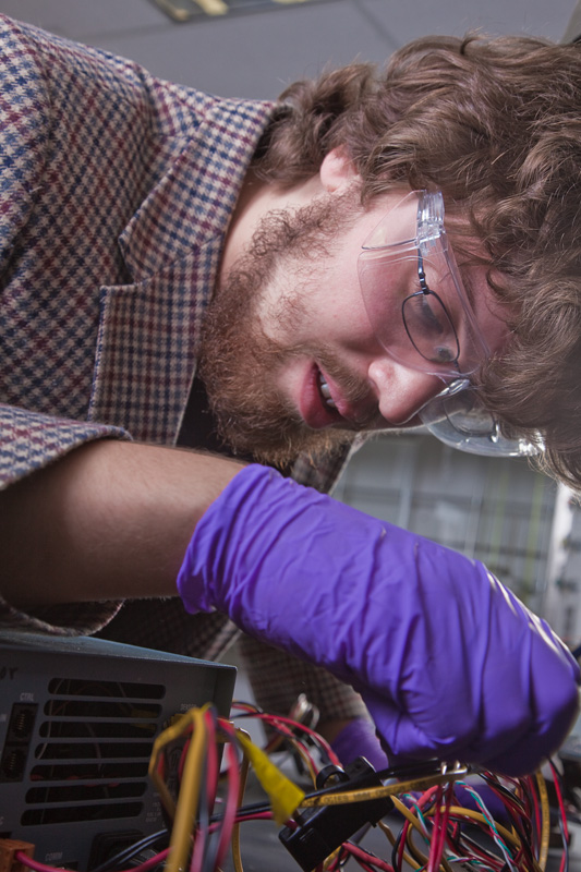 Graduate student Peter Peterson works in a Reichardt Building chemistry lab.